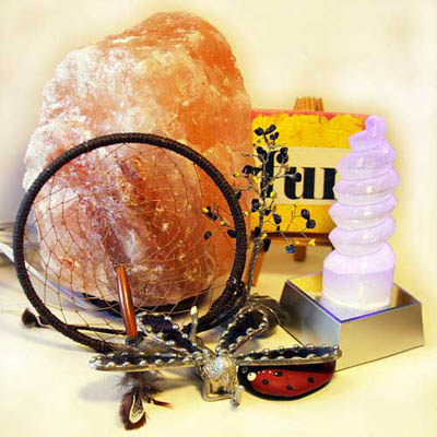 Home décor items including selenite and Himalayan salt lamps