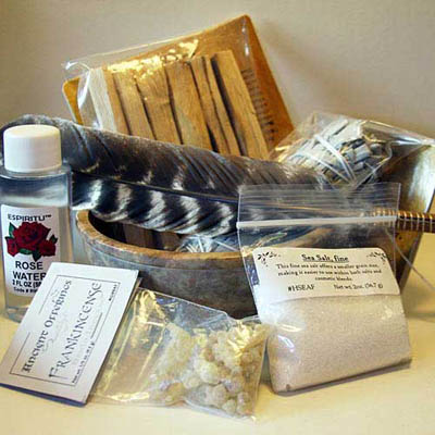 House cleansing and blessing products including sage, palo santo wood, dead sea salt, and rose water